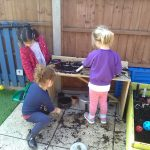 Playing in our Mud Kitchen