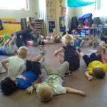 Children having fun coping the adults actions.